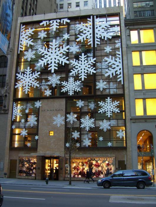 Larger than life elegant snowflakes float across the surface in front of this Burberry space to express the holiday season - Cricket Diane Walkabout New York City 2010.