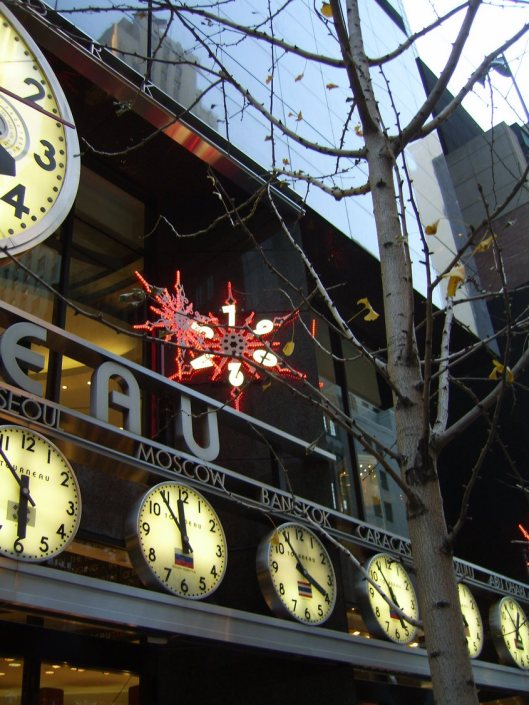 Le Tourneau New York - CricketDiane New York City Walkabout 2010 - Holiday Decorations grace the Le Tourneau clocks showing time across the world next to the winter trees and electrified snowflakes.