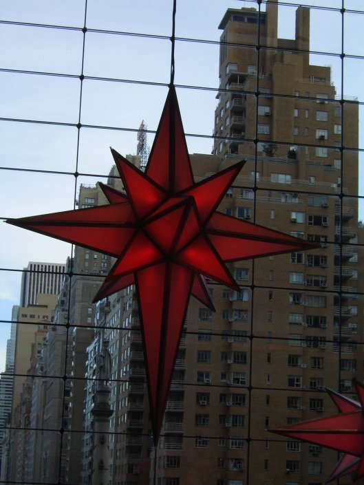 Rising Star in the Time Warner Center atrium - Statue of Columbus sits to the left of its point as buildings appear to float behind it - cricketdiane walkabout tour of New York City 2010.