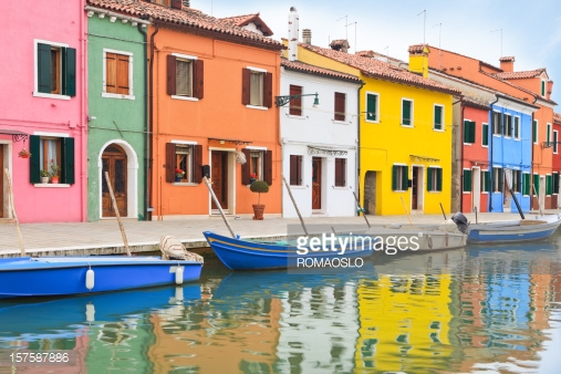 157587886-canal-with-colorful-houses-burano-veneto-gettyimages