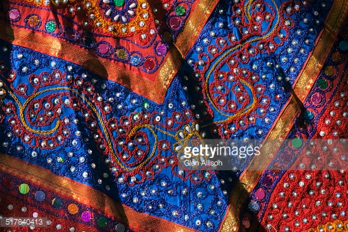 517840413-rajasthani-embroidered-tribal-dress-fabric-gettyimages